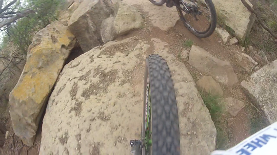 A glimpse of Travis's wheel through the boulders